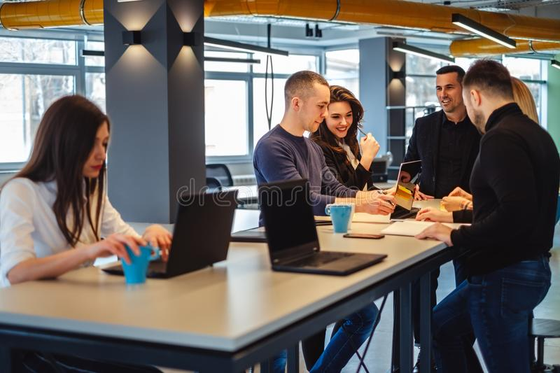 Colleagues smiling while working at the office meeting stock photo