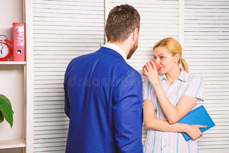 Colleagues spend time coffee break. Conversation between colleagues. Boss and worker discuss working plan. Relations at. Workplace. Friendship and personal royalty free stock photos