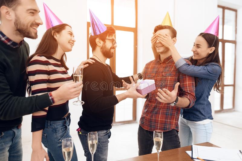Colleagues surprise another employee of the company. stock images