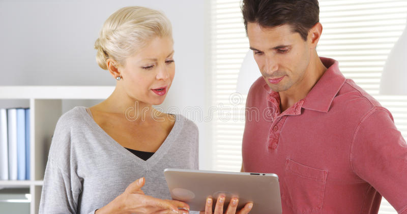 Colleagues talking with tablet in office royalty free stock image