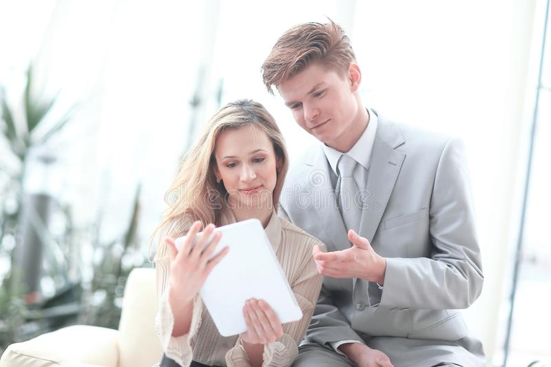 Colleagues use a digital tablet to obtain the necessary information.  stock images