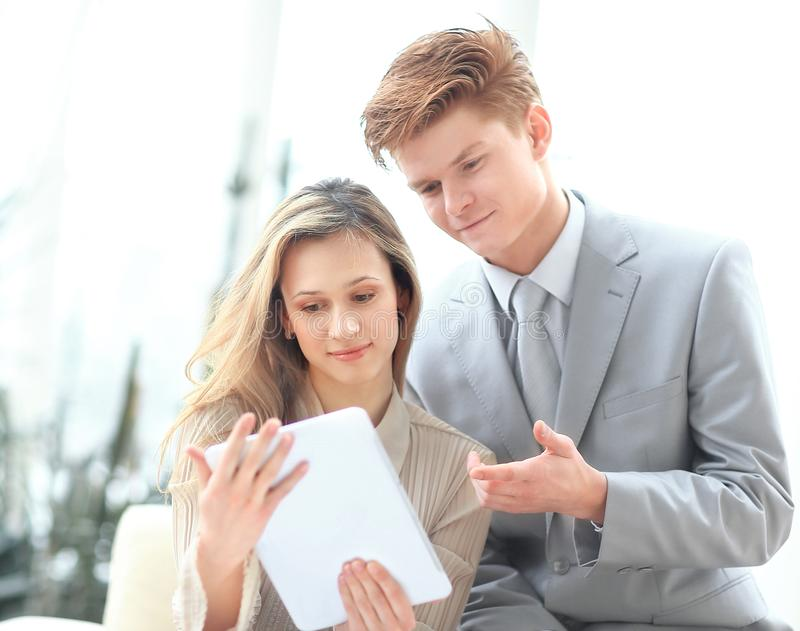 Colleagues use a digital tablet to obtain the necessary information.  royalty free stock photos