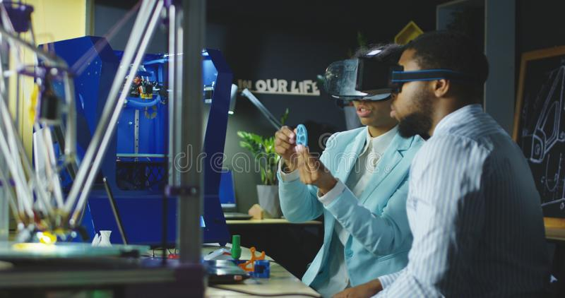 Colleagues in VR glasses having meeting royalty free stock image