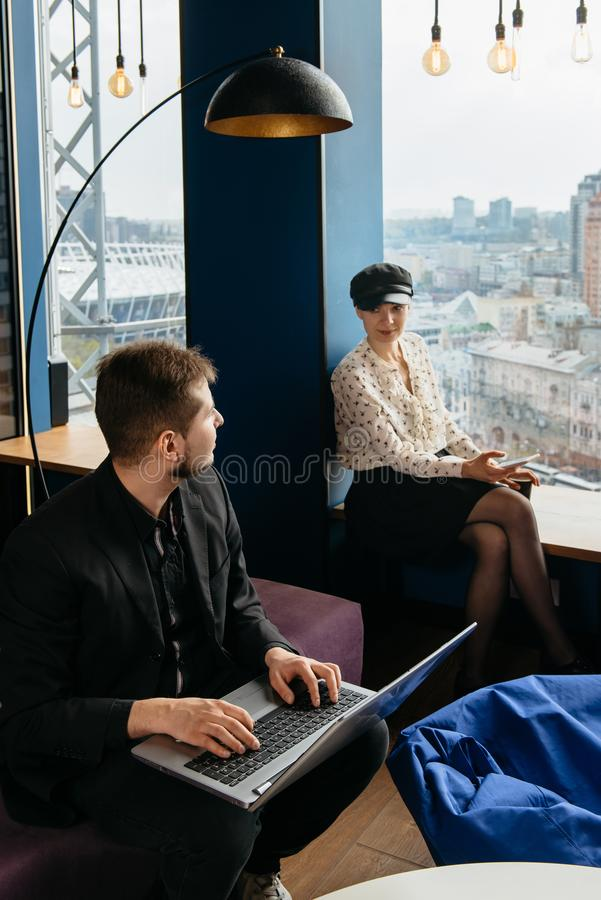Colleagues working in the office with nice city view stock photos