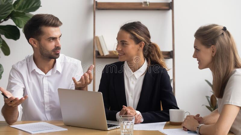 Colleagues working on project together, discussing startup ideas stock photos