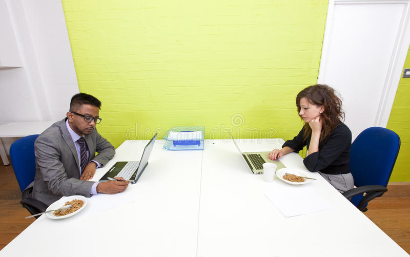 Colleagues working at their desks