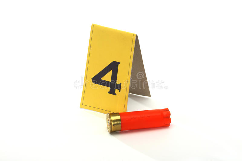 Collect evidence. Shotgun shell marked as evidence on white stock photography