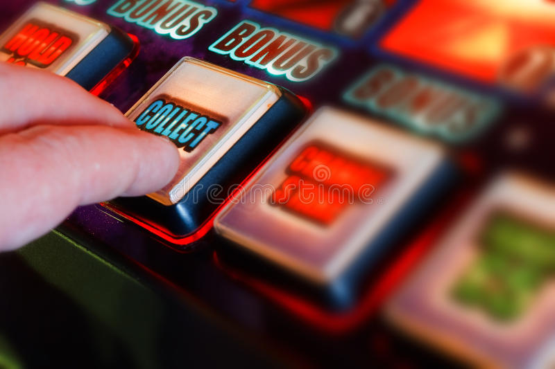 Collect winnings. Successful gambler collecting winnings from one armed bandit stock image