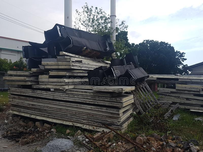 Collected area of used scrap cardboard  paper and wood pallets from general waste management industry. Collected area of used scrap cardboard paper and wood stock image