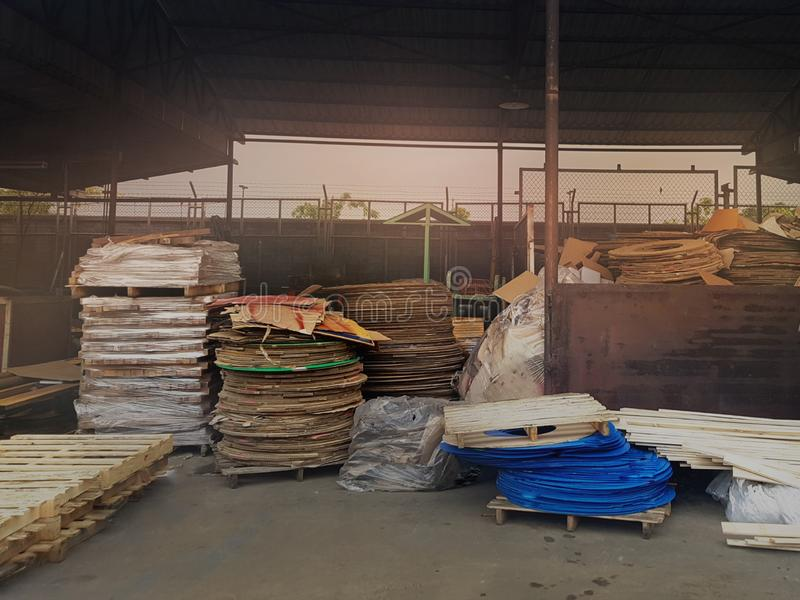 Collected area of used scrap cardboard paper and wood pallets from general waste management industry royalty free stock images