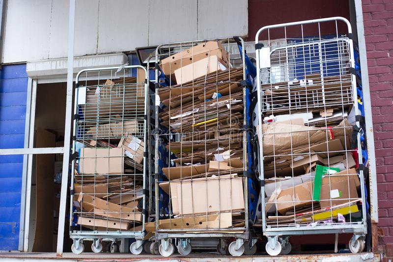 Collected cardboard boxes in a recycling center. An image of collecter used cardboard boxes in a recycling center stock photo