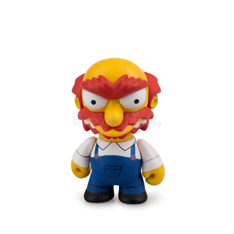 Collectible leksak från tecknade filmen Simpsons på en vit bakgrund royaltyfri foto