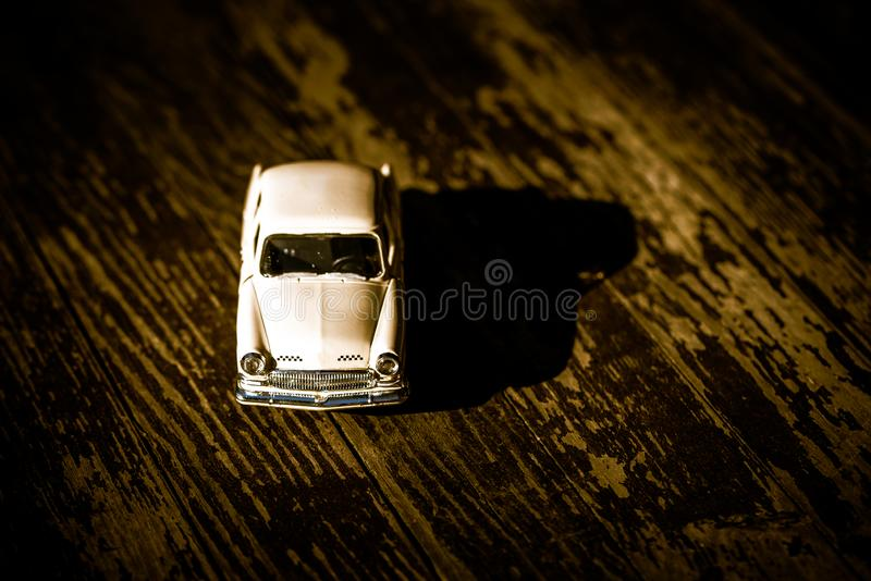 Collectible toy model of an old car with a taxi symbol on a wooden background. Selective focus. Copy space.  stock images