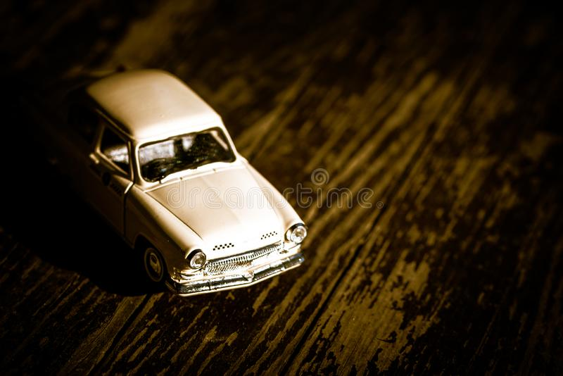 Collectible toy model of an old car with a taxi symbol on a wooden background. Selective focus. Copy space.  stock image