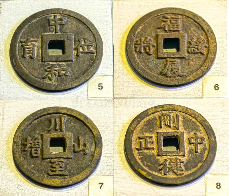 Collectibles ancient large coin in the reign of Minh Mang king 1830 feudal period in Vietnam. This is made of bronze coins were used as prize money for the royalty free stock image