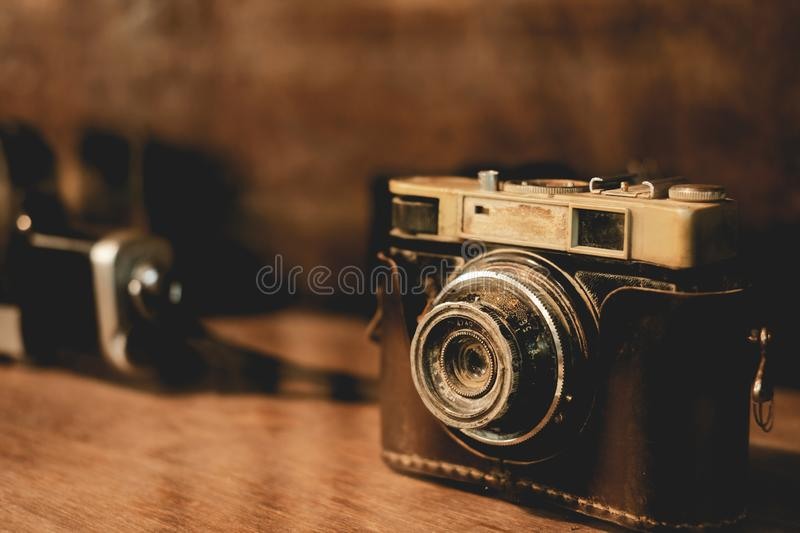 Collectibles Classic and old film camera. Retro technology. vintage color tone stock photo