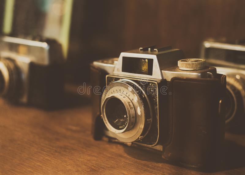 Collectibles Classic and old film camera. retro technology. Vintage color tone royalty free stock images