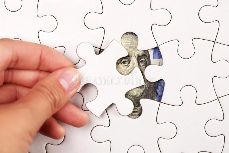 Collecting dollar banknote with jigsaw puzzle. Collecting 100 dollars banknote with pieces of jigsaw puzzle. Concept of teamwork for sucsess stock photo