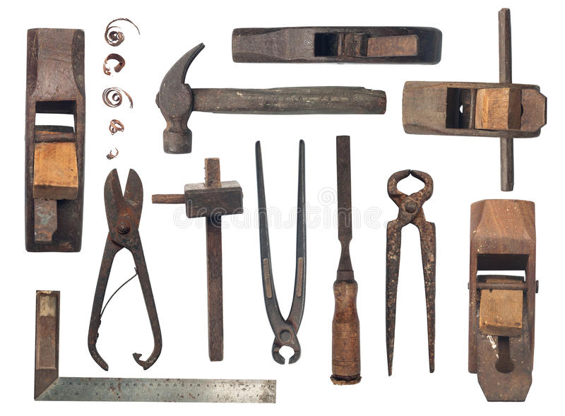 Collection of antique woodworking tools on white cloth royalty free stock images