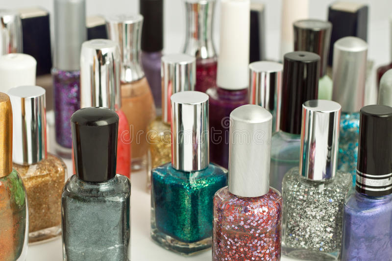 Collection of assorted colored nail polish. Large collection of assorted colored nail polish stock photo