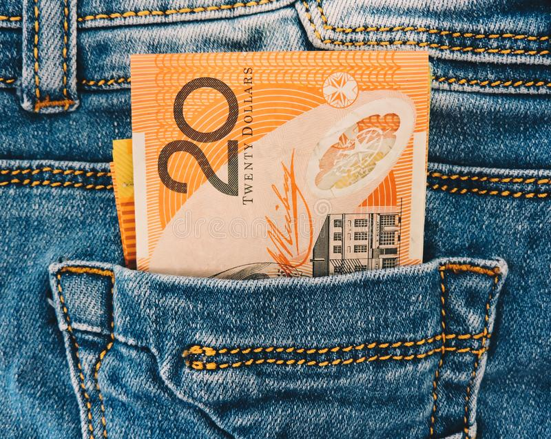 A collection of Australian banknotes.dollars in a jeans pocket, closeup.A few bills of one hundred dollars stick out . stock image
