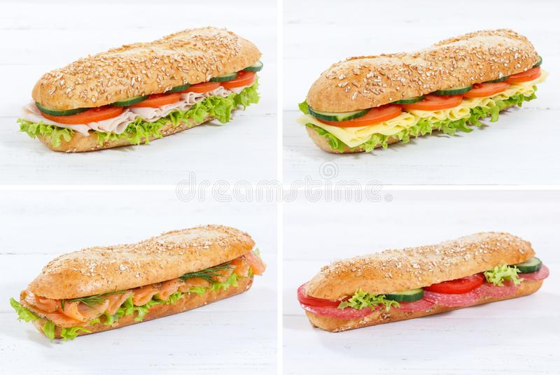 Collection of baguette sub sandwiches with salami ham cheese sal. Mon fish whole grains fresh on a wooden board wood stock photo