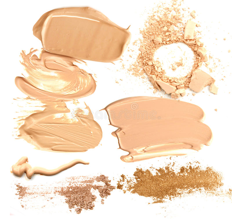 Collection of beige foundation and powder crushed cosmetic products on a white background. stock photography