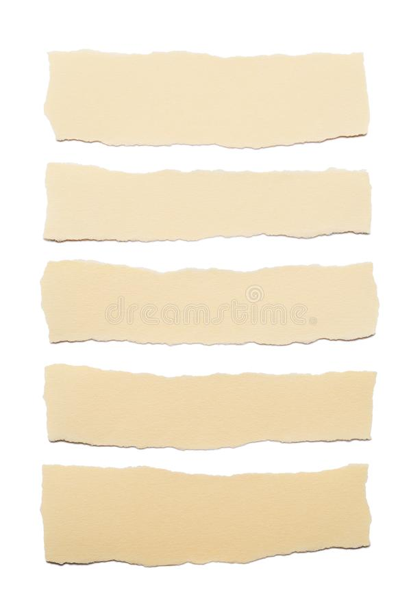 Collection of beige paper stripes with torn edges isolated on white background stock photography
