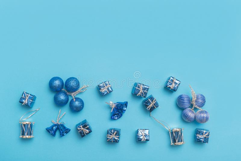 Collection of blue and turquoise miniatures with presents for christmas decoration on blue background royalty free stock photography