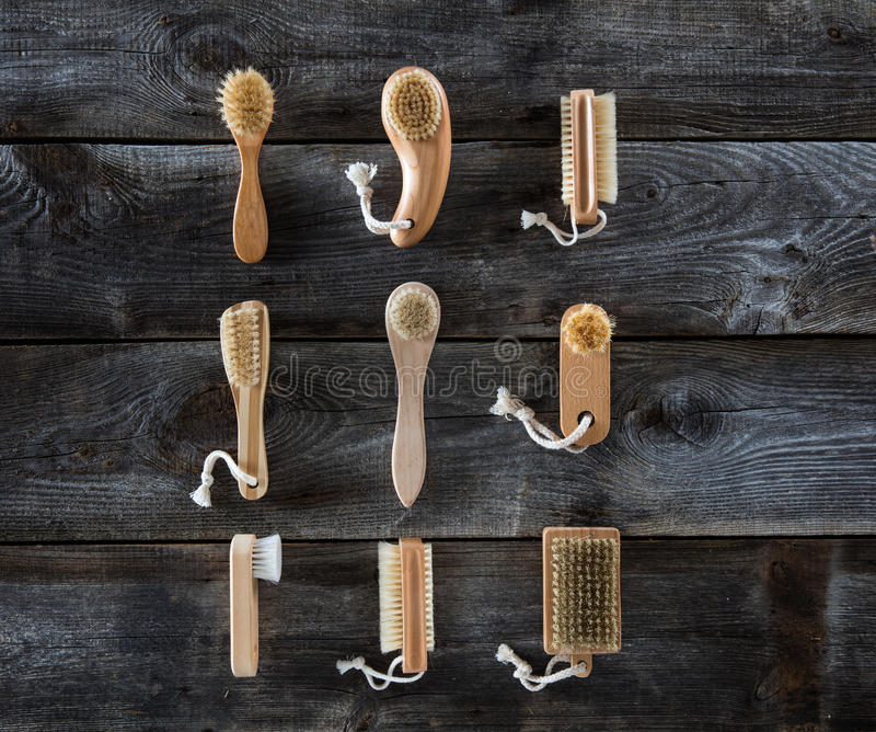 Collection of body brushes on old wood background, top view stock images