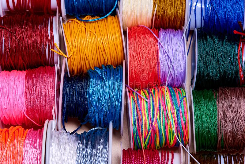 Collection of bright multi-colored ropes close-up stock photography