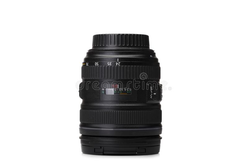 Collection of camera lens, laying on white background. Izolated picutre of black, professional equipment. stock photo