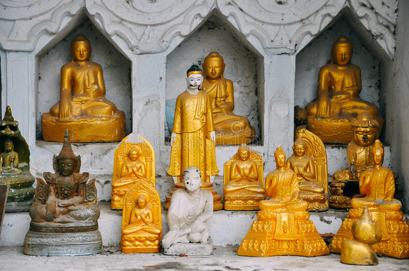 A collection of ceramic Buddha statues. stock image