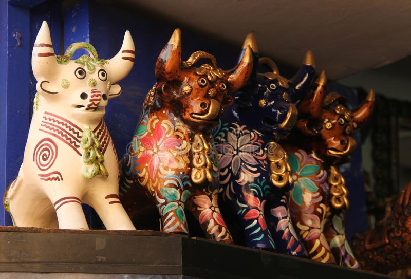 A collection of Pucara Bull statues. A collection of ceramic Pucara Bull Statue made to be placed on the roof for prosperity for sale at the souvenir market in stock photography