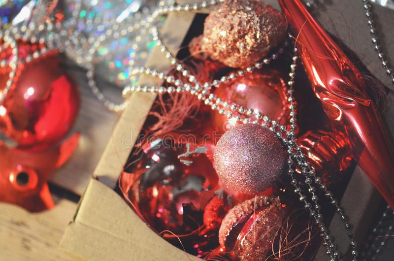 Collection of Christmas decorations into cardboard box stock photo