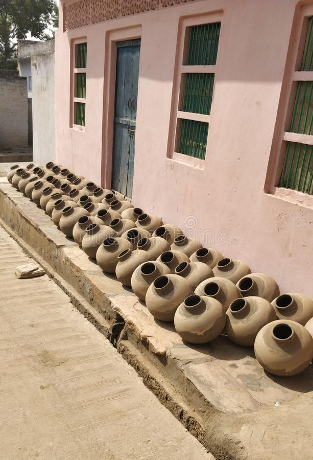 Collection of clay pots known as Matka in Indian Subcontinent. Creation, hand. Collection of terracotta clay pots known as Matka in Indian Subcontinent. Creation royalty free stock photos