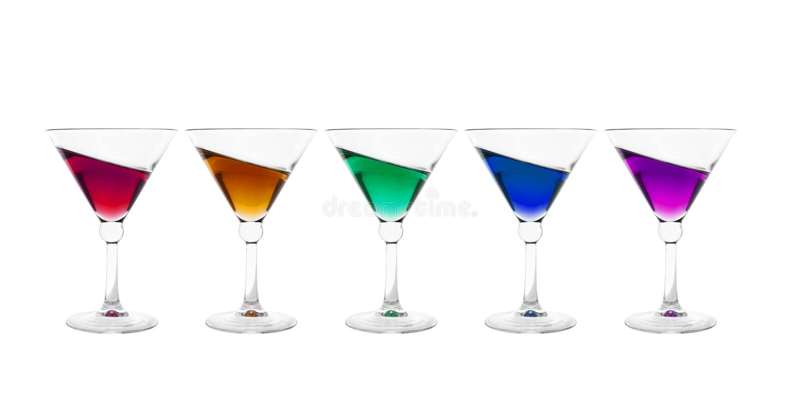 Collection of cocktail glasses filled with colorful inclined wine drink. Isolated on white background royalty free stock images