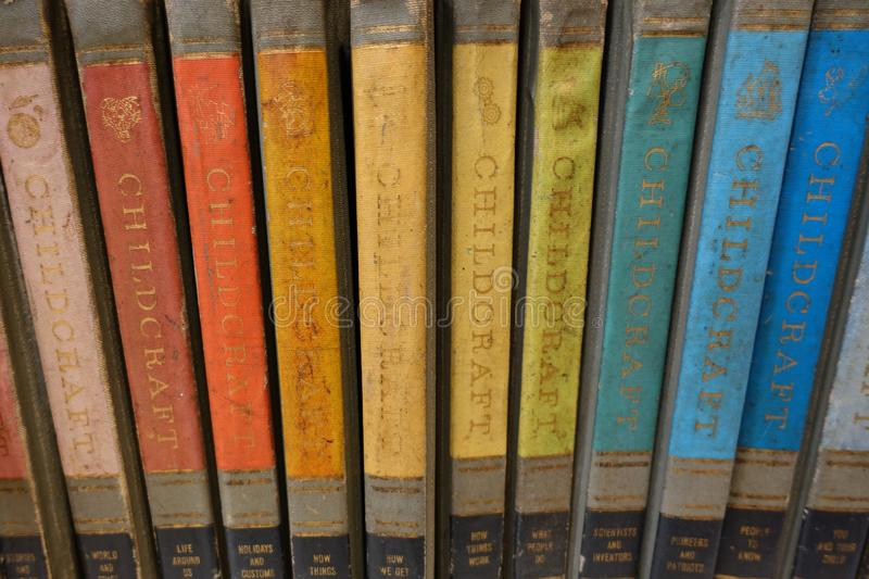 A Collection of Colorful Childcraft Encyclopedias. For sale in a thrift store stock photo