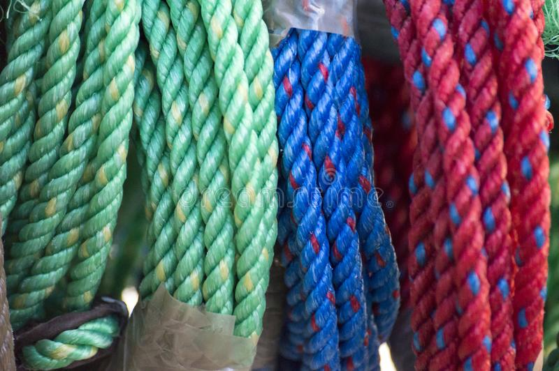 Green, Blue and Red Polypropylene Ropes. Collection of colorful polypropylene ropes for sale stock photos