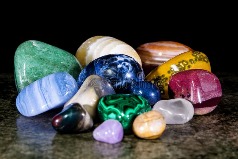 Collection of colorful trumbled mineral stones, gemstones and healing stones stock photos