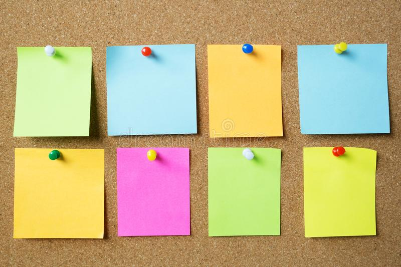 Collection of colorful variety post it. paper note reminder sticky notes pin on cork bulletin board Note reminder. empty space for royalty free stock images