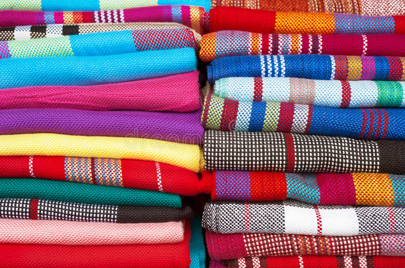 Collection of colourful woolen scarfs. FENGHUANG, CHINA - Miao-style fabric on sale in Fenghuang, Hunan Province royalty free stock photos
