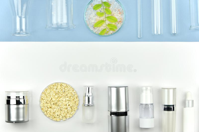 Collection of cosmetic bottle containers and laboratory glassware, Blank label for branding mock-up royalty free stock photos