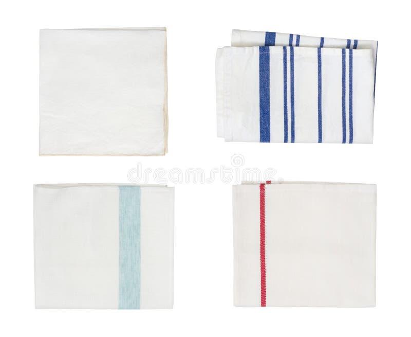 Collection de différentes serviettes de cuisine pliées d'isolement sur le fond blanc image stock