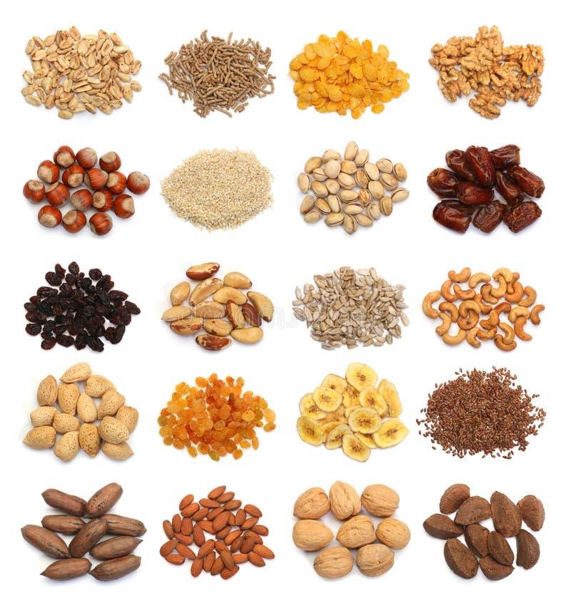 Collection de fruits, de céréales, de graines saines et d'écrous secs d'isolement photos stock