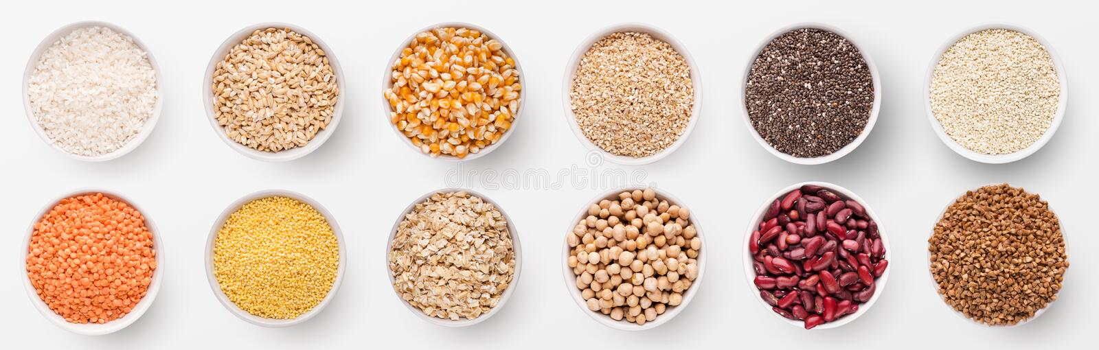 Collection of different grains and beans in bowls stock photography