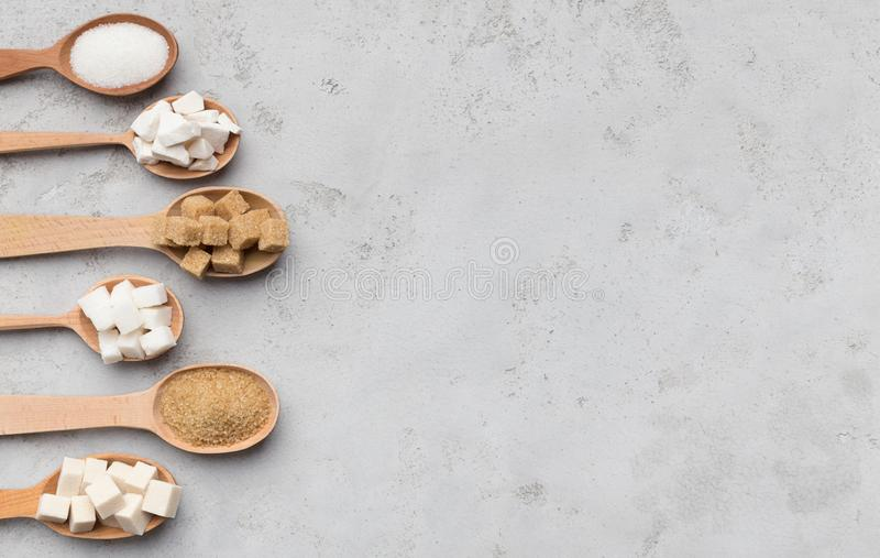 Collection of different kinds of sugar on gray background royalty free stock image