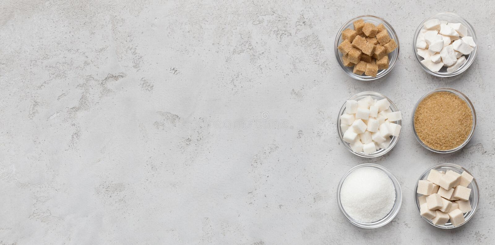 Collection of different kinds of sugar on gray background royalty free stock photos