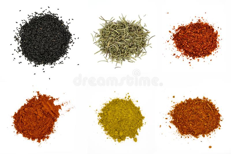A collection of different spices on white background royalty free stock photos
