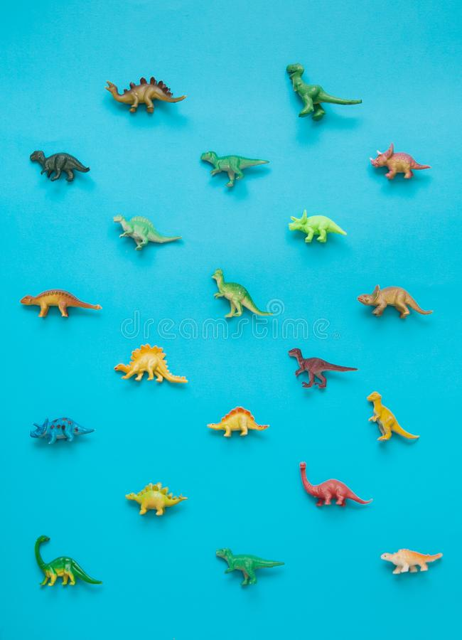 Collection of dinosaurs toys. Collection of dinosaurs toys on blue background stock image